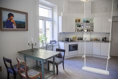 See and Feel Spatial Design Finland - Combination of vintage furnitures, and modern kitchen design, and a Swing like in the summerhouse