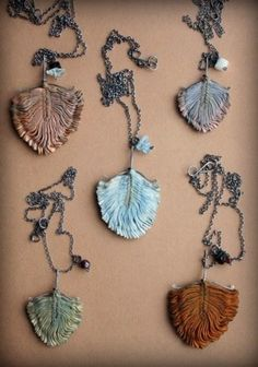 recycled fabric necklaces  inctory: naturally dyed vintage fabric jewelry    Tinctory are brilliant fairy-like jewelry designs by Eva a Czech designer living in the UK. Using fabric manipulation she folds vintage and new dyed fabrics into accordian-esque geometries.