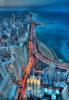 Been there:  Chicago. This looks like a view from the top of the Sears Tower, as it was called back then. So high up that planes and clouds were below us.