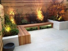 Patio Seating Area - plank seating and rendered low walls