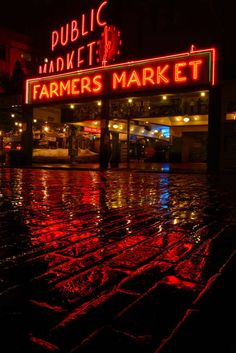 """Market Rain"" by Frank Melchior, Edmonds, WA // Seattle's famous Pike Place Market taken on a rainy night just inches from the street.  This image used for the benifit concert, and silent auction for the Seattle Symphony. (J: Been here)"