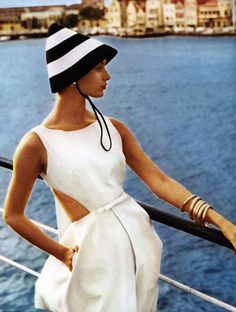 Dress by Jean Campbell for Sportswhirl, hat by Madcaps & bracelets by Monet. Photo by Herman Landshoff in Curacao for Mademoiselle, 1959.