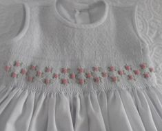 Hand smocked dress with delicate pink flowers. Adorable bishop dress for a special occasion. Perfect as a Naming, Christening day or Wedding. This dress has smocking on the blouse and is embroidered with gorgeous pale pink rose buds. Appropriate for Flower girl, Bridal Party,
