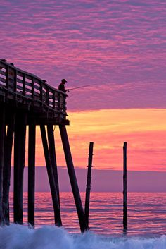 Sunrise silhouette at Kitty Hawk pier, Outer Banks, NC coast