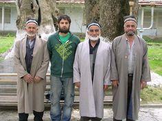 Uzbek men wear plain chapan influenced by European fashion.