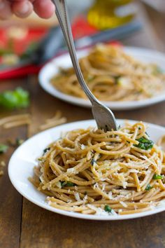 This garlic butter spaghetti with herbs is a simple twist on the traditional. Made with a garlic butter sauce, fresh basil and spinach, and Parmesan cheese.
