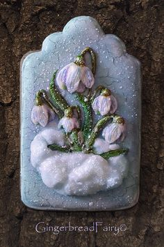 Premonition of spring, snowdrops in the snow, cookie artist Gingerbread Fairy