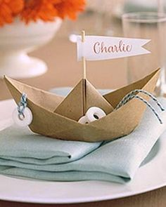 Paper boat with a flag with a name on simple and easy to make