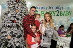 Pin for Later: Jessica Alba's Sweet Family of 4 Really Belongs in Those Store-Bought Frames  The family cuddled up at the Baby2Baby holiday party in December 2014.