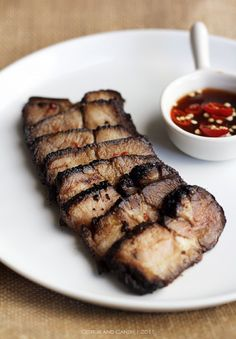 Not usually a huge pork gal, but this grilled pork neck with Issan dipping sauce looks bomb