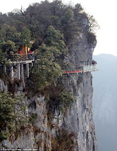 Glass bottomed walk way on the side of a cliff in China. If that is glass bottomed, I would be passed out!
