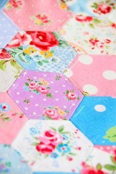 Helen Philipps Sweet way to use fabric scraps, mini hexagons :)