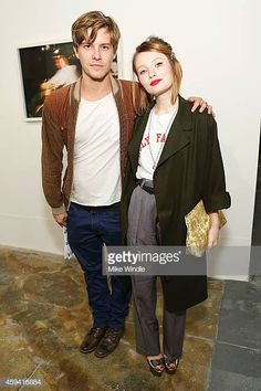 Actors Xavier Samuel and Emily Browning attend The Holy Other A Series Of Photos by Jena Malone Opening Reception on November 21 2014 in Los Angeles. Xavier Samuel, Emily J, Jena Malone, Emily Browning, Women In Music, Attractive Guys, Still Image, Holi, Bomber Jacket