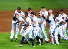 ATLANTA, GA - JUNE Andrelton Simmons of the Atlanta Braves is mobbed by teammates after knocking in the game-winning run in the inning against the Pittsburgh Pirates at Turner Field on June 2013 in Atlanta, Georgia. Braves Baseball, Better Baseball, Atlanta Braves, Atlanta Georgia, Tomahawk Chop, Turner Field, Mlb Games, Baseball Pictures, Sports Fanatics
