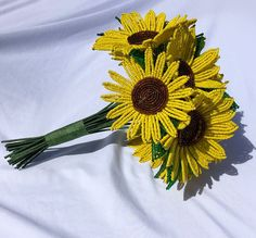 This rustic and classic sunflower bouquet was created using the French Beaded Flower technique. There are nine sunflowers in various sizes with