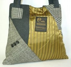 purses created from reclaimed and recycled men's suit coats.
