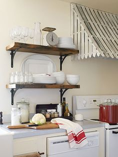 Tin awning over stove and wooden shelves. Would go underneath the tin awning