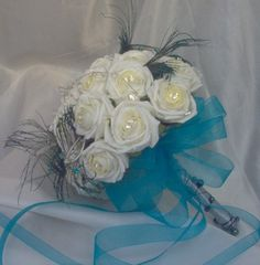No Teal/Navy flowers? Use ribbons, feathers, and/or jewels on a white bouquet!