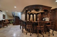 Beautiful Old World style home bar with a very expensive wrought iron bannister.