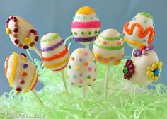 Make your Easter sweeter with these Easter Egg Cake Pops! Moist bites of cake and frosting are formed into lollipops and decorated to look like Easter eggs.
