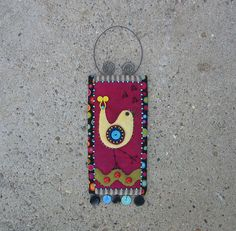 bird folk art wall hanging - hand sewn - celebrating with beads, buttons, and stitches