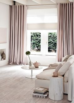 Pale colour scheme + floor to ceiling curtains.                                                                                                                                                                                 More