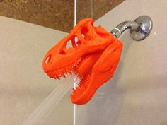 3D print a T-Rex shower head! Download the files and instructions free from Thingiverse. Design by JMSchwartz11
