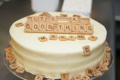 Andie and Jason Moore, owners of Andie's Specialty Sweets created these truly inventive candy Scrabble chips and displayed them on this cake at the Wedding party.  www.etsy.com/shop/andiespecialtysweets