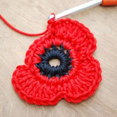 Crochet Puff Flower Get those hooks out. here's a free Remembrance Poppy Crochet Pattern. - Get those hooks out. here's a free Remembrance Poppy Crochet Pattern. Poppy Crochet, Crochet Poppy Free Pattern, Beau Crochet, Crochet Puff Flower, Crochet Motifs, Crochet Flower Patterns, Crochet Designs, Crochet Stitches, Knitting Patterns