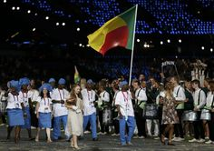 Benin's flag bearer Jacob Gnahoui holds the national flag as he leads the contingent in the athletes parade during the opening ceremony of the London 2012 Olympic Games at the Olympic Stadium July 27, 2012.