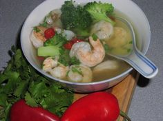 Shrimp in a Spicy Ginger-Cilantro Broth - Clean Eating 4 cups chicken broth, reduced sodium 1 bunch cilantro 2 inches ginger, fresh, peeled 2 garlic cloves 1 chili pepper, Thai 1 lb cooked shrimp, peeled and deveined 1 cup frozen asian-style vegetables	 (can use steamed fresh)