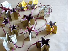 paper star garland -- would be great out of all white/script paper. Glitter?