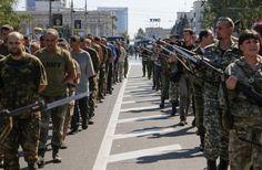 PHOTOS: Pro-Russian rebels force-march Ukrainian prisoners of war along main street of Donetsk http://reut.rs/1nu6SPq pic.twitter.com/90H1BjB1ZU