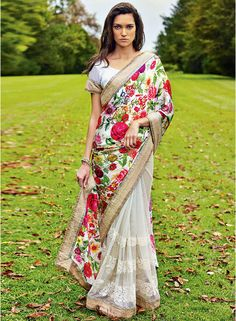 Classy white premium fabric half and half saree which is adorned with resham embroidery work on the first half in the horizontal panel, floral printed work on the pallu part and lace work on the border. Matching blouse piece attached with this attire. Indian Attire, Indian Ethnic Wear, Saris, Indian Dresses, Indian Outfits, Indian Clothes, Lehenga, Anarkali, Indische Sarees
