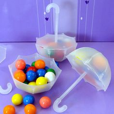 "These Miniature Frosted Plastic Umbrellas are perfect for showers! Just add candy! 12 pieces come per package. Each Umbrella Favor measures approximately 4"" tall x 3"" wide."