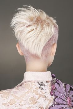 short blonde straight coloured multi-tonal choppy shaved-sides womens haircut rear-view hairstyles for women