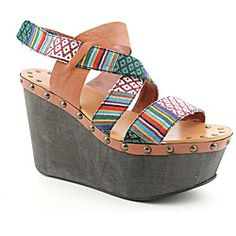 @Overstock - Step out with your walk held high in this unique sandal from Joe's Jeans. The Trixie features a printed fabric and leather strap upper with crisscrossing detail and adjustable velcro closure. Soft lining and cushioned insole provides comfortable...http://www.overstock.com/Clothing-Shoes/Joes-Womens-Trixie-Brown-Sandals/6760950/product.html?CID=214117 $103.99