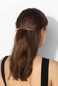 Pull back your hair with a chic gold barrette.