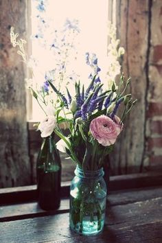 Mason jars and wild flowers for an elegant, natural, feel.