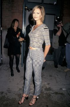 Pin for Later: Celebrate Charlize Theron's Birthday With Her Best Looks! Charlize Theron Style An early appearance at a film premiere in matched stripey knits. Charlize Theron Style, Blonde Actresses, Atomic Blonde, 90s Outfit, Famous Women, Famous People, Sensual, Fashion Pictures, Beautiful Actresses