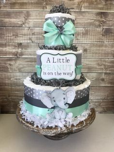 Little Peanut Diaper Cake in Mint and Gray, Elephant Baby Shower Centerpiece, Little Peanut Baby Shower Decorations by AllDiaperCakes on Etsy https://www.etsy.com/listing/588393646/little-peanut-diaper-cake-in-mint-and