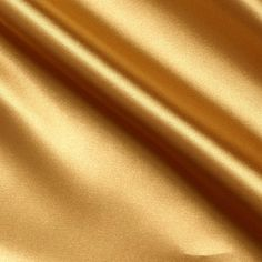 Stretch Charmeuse Satin Sungold from @fabricdotcom  Get a high style look in this sophisticated stretch charmeuse satin fabric! This gorgeous fabric has a lustrous sheen that beautifully reflects the light, a soft hand and a wonderful drape. It is perfect for creating special occasion apparel, blouses, dresses, lingerie and skirts.   Fabric has 10% stretch across the grain for added comfort and ease.