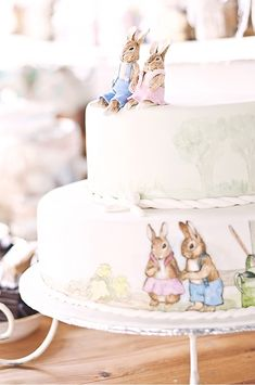 Beatrix potter baby shower cake! We could do a beatrix porter themed shower and use all of the BP stuff that Alicia and I have saved from our nursery!