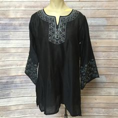 Black tunic Well made Paras black tunic.  Feels like raw silk but there is not label with fabric details.  Would fit a small to petite medium Paras  Tops Tunics