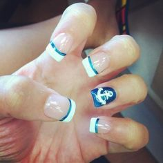 White tips with blue outline and blue accent nail with anchor