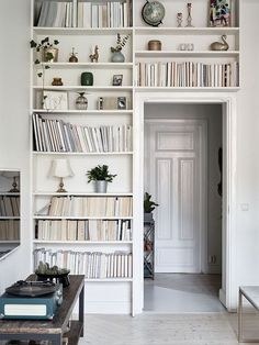 tip: turn book binding to face the wall for a chic bookshelf upgrade