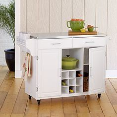 another kitchen island I could be happy with. it's white, but has a stainless-steel top. Hmm. good second contender.