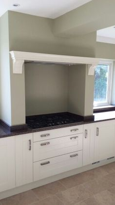 The beam above the hob meant a traditional chimney extractor was out of the… Shaker Kitchen Diy, Kitchen Hob, Zoes Kitchen, Kitchen Cooker, Kitchen Dinning, Diy Kitchen, Kitchen Design, Kitchen Ideas, Kitchen Decor
