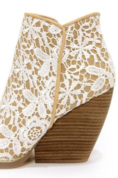 """Careful, the Very Volatile Tallulah White Multi Lace Ankle Boots have been known to break a few hearts! White crochet lace overlay adds a feminine feel above beige fabric on a two-part ankle height shaft with beige faux leather trim. A stacked, 4"""" tall wood heel (including tip) offers a wedge look thanks to its wide, chunky style. 4.5"""" zipper at instep. Smooth insole. Non-skid felted sole. Available in whole and half sizes. Measurements are for a size 6. Man made materials."""