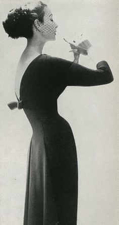 A tiny waist is what makes a woman a dreamy vision.  Lillian Bassman  Harper's Bazaar 1956